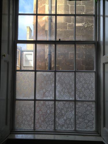 fabric on windows privacy screen diy easy cornstarch water paintbrush4
