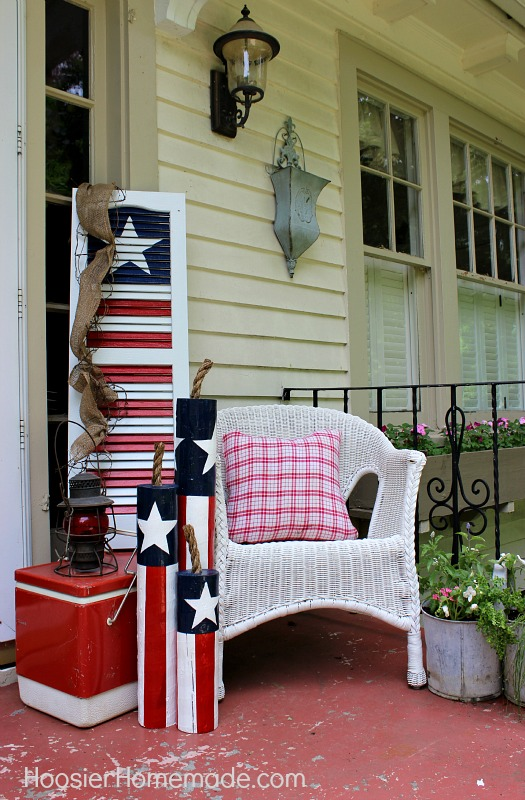 Celebrate Independance Day with these Patriotic Porch Decor Ideas flags diy budget shutter tissue paper firecrackers flowers pillows plants accessories party bbq get together patriotic july 4th1