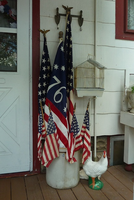 Celebrate Independance Day with these Patriotic Porch Decor Ideas flags diy budget shutter tissue paper firecrackers flowers pillows plants accessories party bbq get together patriotic july 4th6