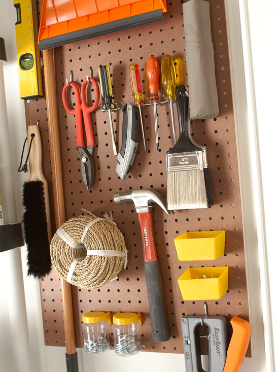 Oraganize Your Garage With These Simple Ideas and Storage Solutions shelves storage tidy organization2