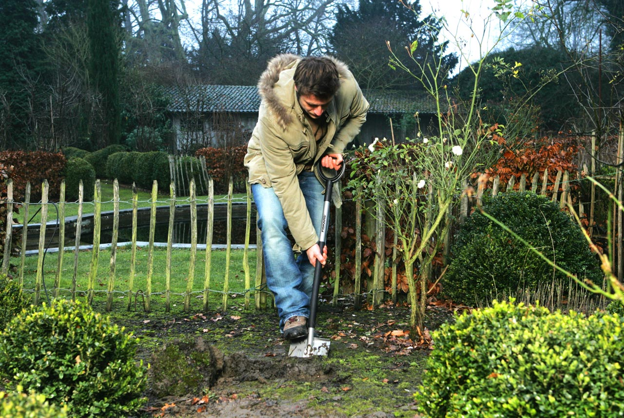 It's Time to Prep Your Garden for Next Year - Here's How soil soil testing spade weeds organic matter1