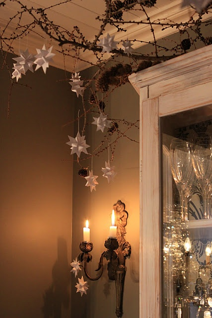 10 Rustic Christmas Decor Ideas You Can Recreate on the Cheap branches reindeer snowflakes stars moss wood thrift store easy budget friendly1
