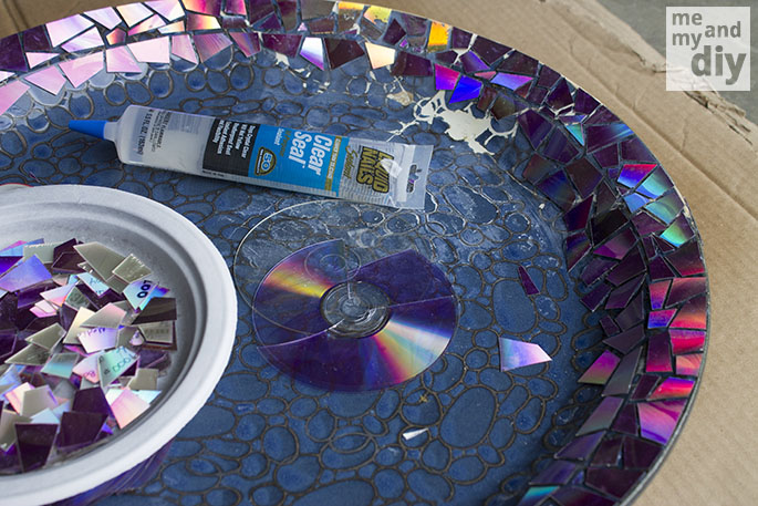Give Your Old Birdbath a Makeover This Spring Using Old DVDs! 16