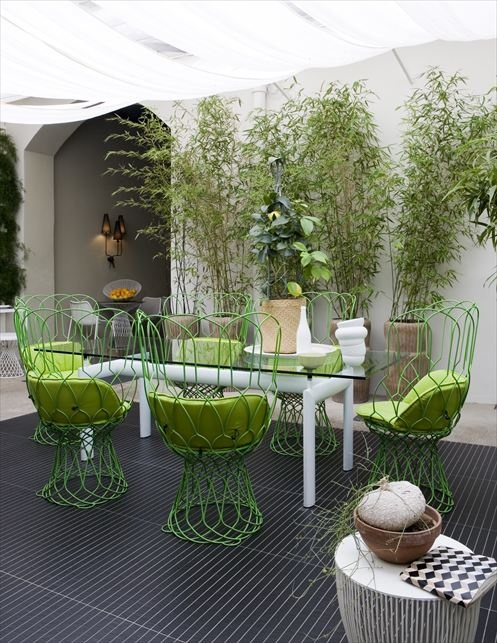 apple green summers hottest hue patio garden chairs cushions walls plants decor decorating summer