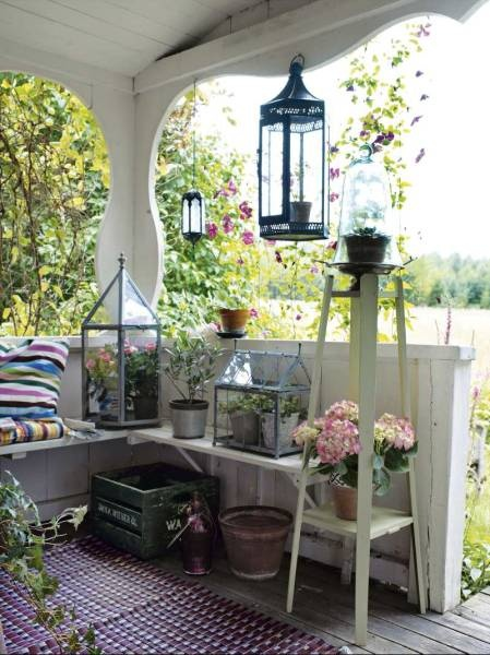 Porch Season - 7 Ideas to Spruce up Your Porch this Summer lighting candles lanterns plants flowers diy easy3