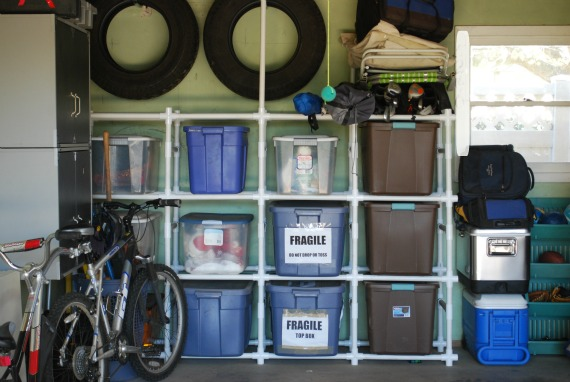 Oraganize Your Garage With These Simple Ideas and Storage Solutions shelves storage tidy organization7