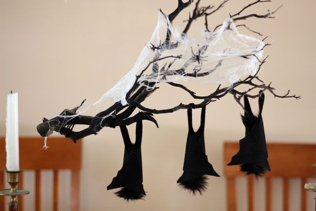 Make This Hanging Bat Centerpiece For Your Halloween Party! glue felt fake fur spray paint branch easy budget1