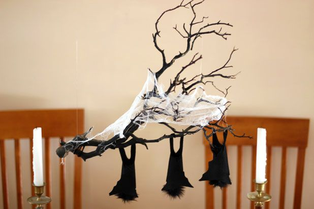 Make This Hanging Bat Centerpiece For Your Halloween Party! glue felt fake fur spray paint branch easy budget11