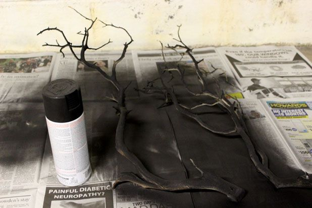 Make This Hanging Bat Centerpiece For Your Halloween Party! glue felt fake fur spray paint branch easy budget2