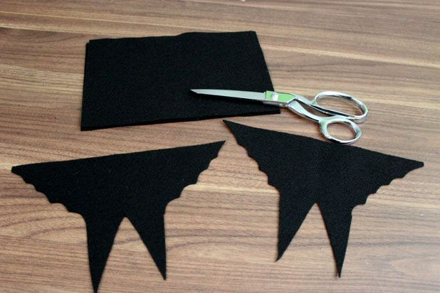 Make This Hanging Bat Centerpiece For Your Halloween Party! glue felt fake fur spray paint branch easy budget3