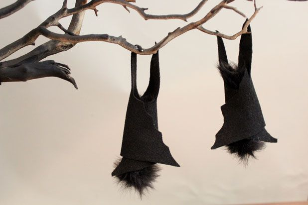Make This Hanging Bat Centerpiece For Your Halloween Party! glue felt fake fur spray paint branch easy budget7