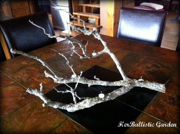 Make This Branch Candle Centerpiece For Christmas This Year glue candles decor holidays easy diy5