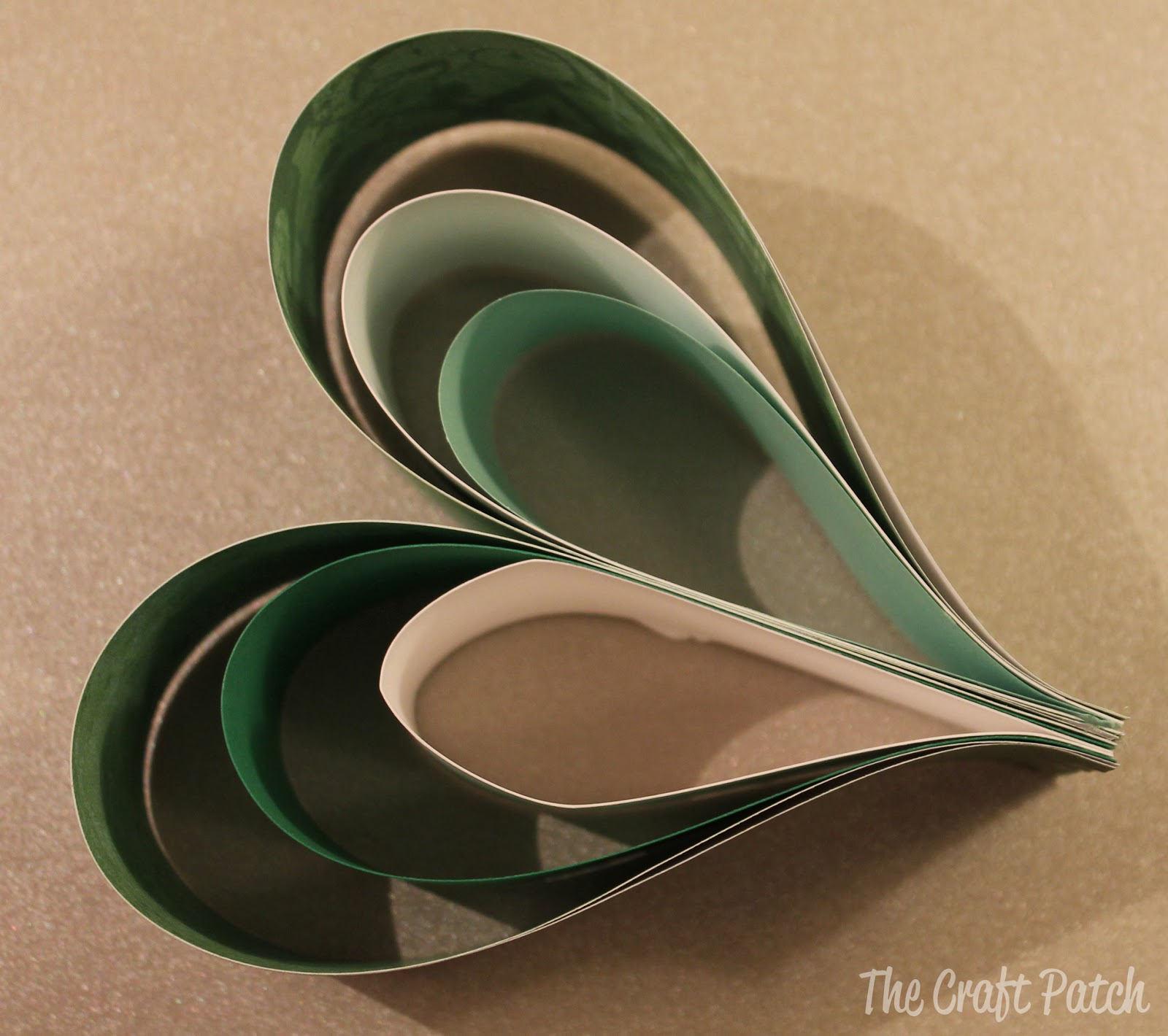 Dress Up Your Home For St. Patrick's Day by Making This Cute Wreath Out of Scrapbook Paper!5