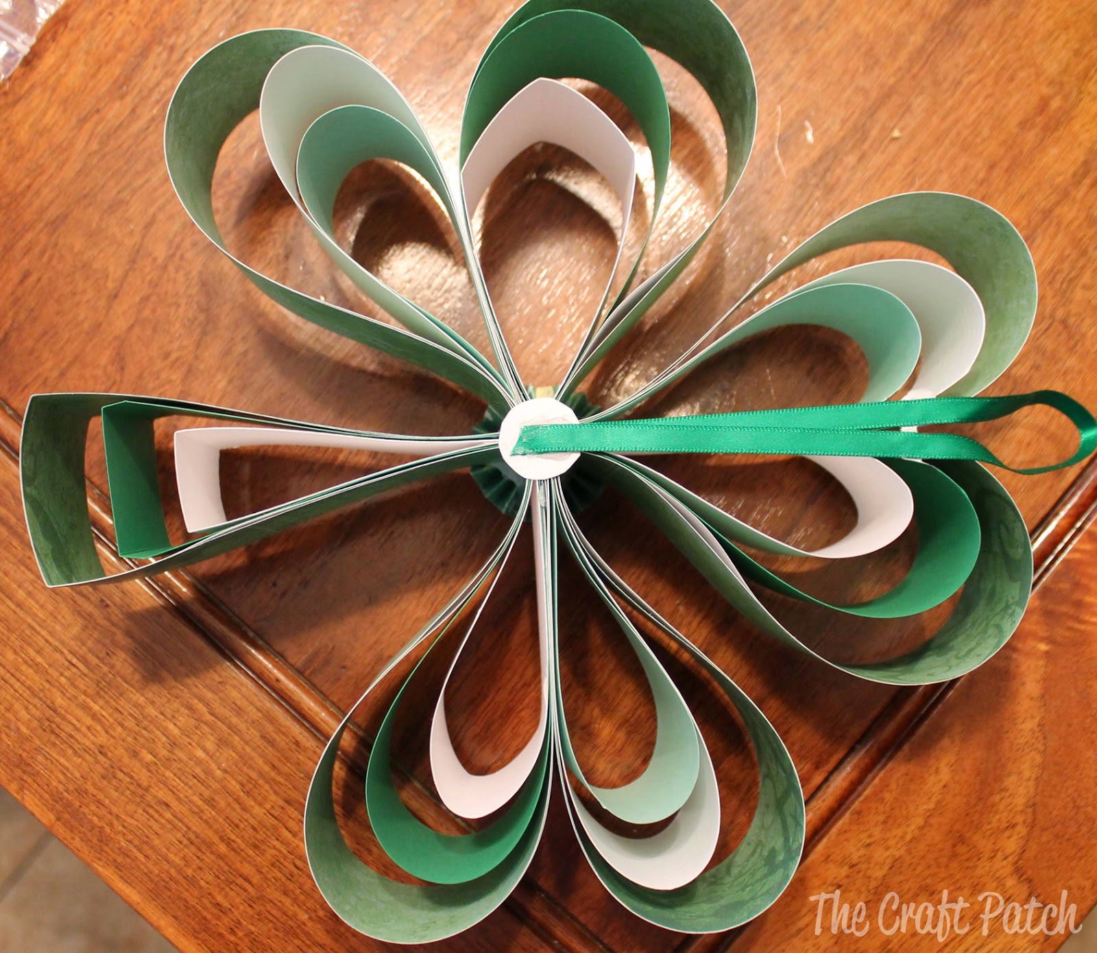 Dress Up Your Home For St. Patrick's Day by Making This Cute Wreath Out of Scrapbook Paper!8